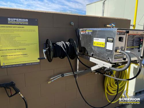 Close up of safety sign and pressure washer system